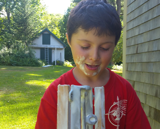 My son enjoying the ice cream left on the dasher after making ice cream the old way with my father.