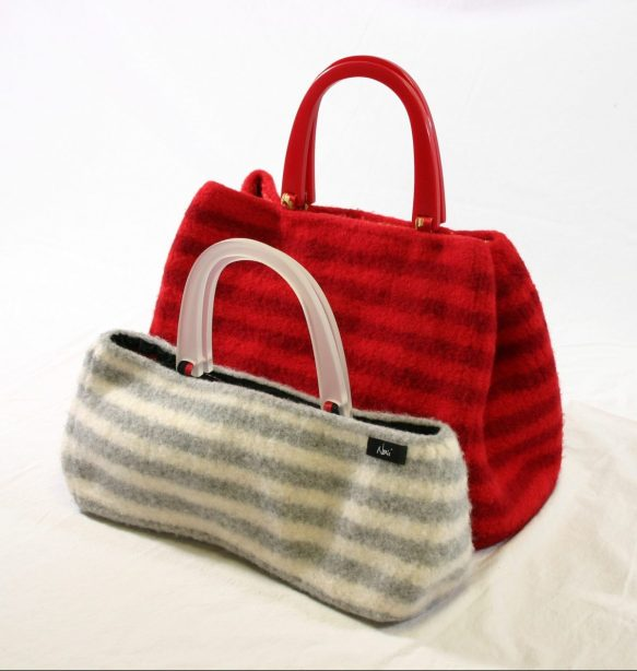 The medium and small sized carpet bags are shown in an alternate, slightly side view.
