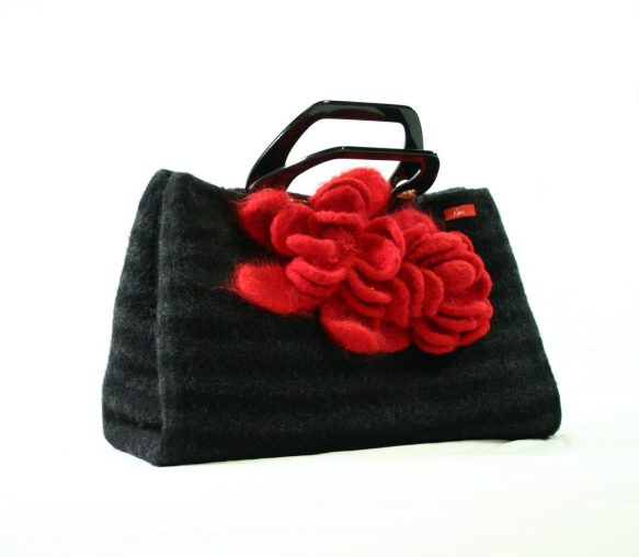 Large black and grey striped felted purse with black handles and huge red felted flower in the front center of the bag.