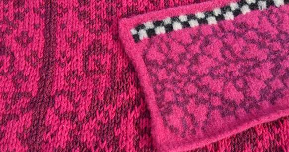 A swatch of felted fabric sets on top of a knitted (not yet felted) fabric of the same pattern to show the difference between felted and unfelted knitting.
