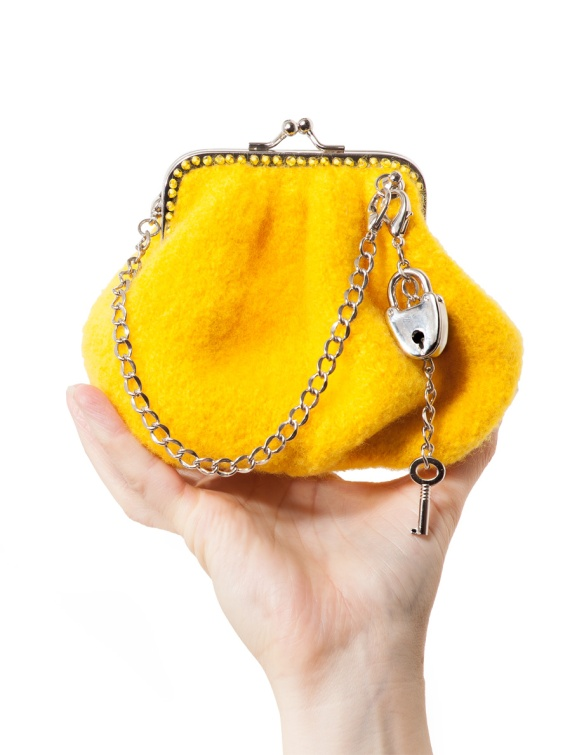 "A bright yellow felted ""Lipstick and Change""  purse is held aloft in the hand of purse designer Nora J. Bellows's hand."